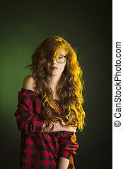 Glamorous young model with long wavy hair wearing glasses