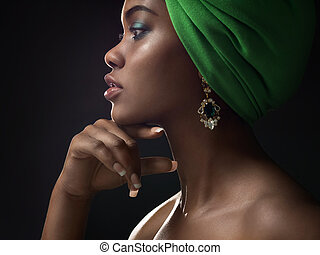 Beautiful young african girl in the studio
