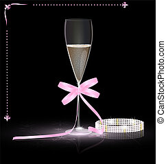 on a dark background is a glass of champagne with pink bow