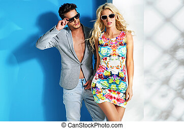 Glamour couple wearing trendy summer stuff