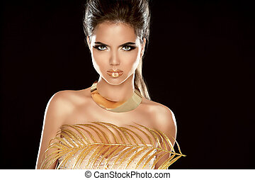 Glamour Fashion Girl Model Portrait with Luxury Golden Jewelry. Isolated on black background