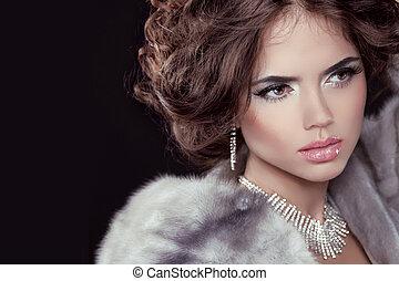Glamour. Fashion girl Model wearing in Luxury Mink Fur Coat isolated black background.