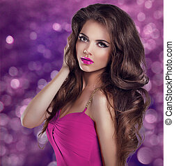 Glamour Fashion Woman Portrait. Long Wavy Hair and Sexy Makeup. Girl model posing on Christmas blinking background