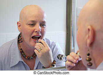 Glamour in Adversity - A beautiful cancer survivor applying...