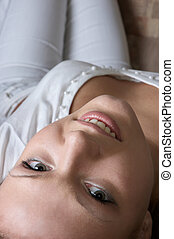 glamour in white - young glamour woman in white laying on ...