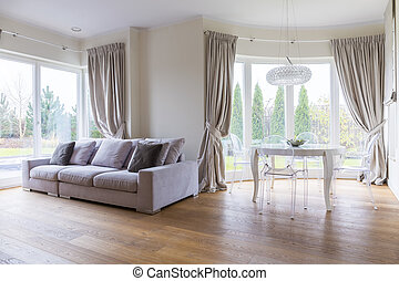 Glamour living room interior with cozy dining area