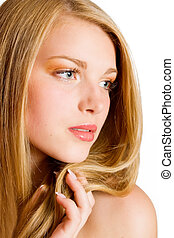 Glamour portrait of beautiful blond woman model with fresh daily makeup and healthy hair. Fashion shiny highlighter on skin and sexy gloss lips make-up