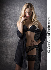 sexy blonde girl with dark lingerie