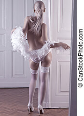 glamour shot of a long hair blonde in lingerie