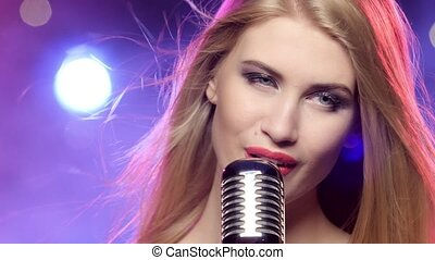 Glamour singer girl with retro microphone long blonde hair developing