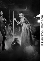 Glamour style photo of posing girl with mannequins