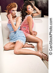 Glamour style photo of two cute girls