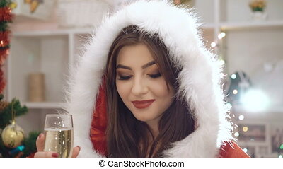 Glamour woman drinking champagne and flirting at camera in 4K