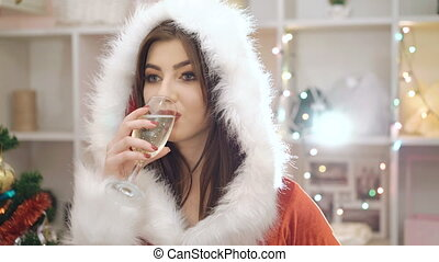 Glamour woman drinking champagne and flirting at new years eve party in 4K