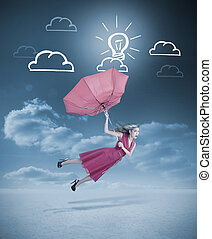 Glamour woman flying with a red umbrella under drawings of...
