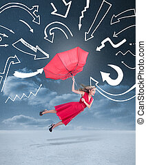 Glamour woman flying with an umbrella under drawings of...