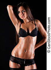 glamour woman in lingerie on dark background