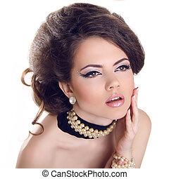 Glamourous closeup female portrait. Fashion evening elegance eyeliner makeup on model eyes. Cosmetics and make-up