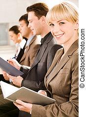 Glance at camera - Image of business woman glancing at...