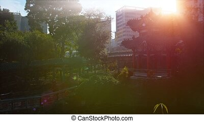 Glare of the Sun over a Pagoda in a Buddhist Temple Garden