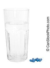 glas vand, og blå, pillerne