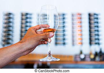 glass against tasting room background