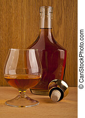 glass and a bottle of alcohol
