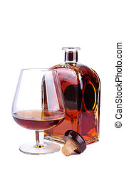 glass and bottle of cognac or brandy with cork isolated on a...