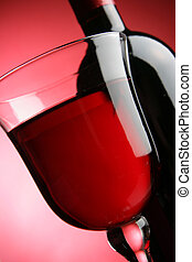 Glass and bottle of red wine - Glass and bottle of wine over...