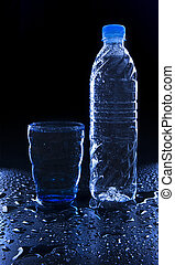 glass and bottle on freshness drinking water on wet floor with copy space use for healthy food and beverage drinking water