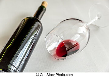 Glass and bottle with red wine