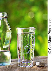 Glass   and cold water.