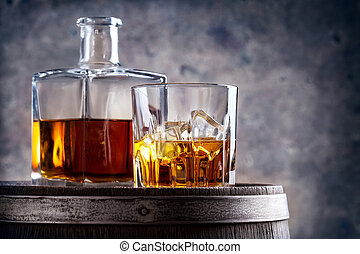 Glass and decanter of whiskey on barrel - Glass and decanter...