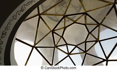 Glass and golden metal ceiling - A panning, low angle,...