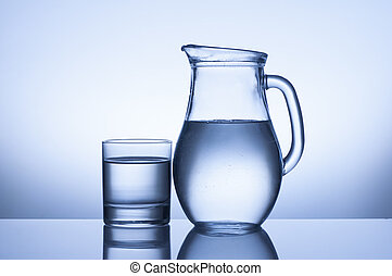 glass and jug  - water glass and jug on blue background