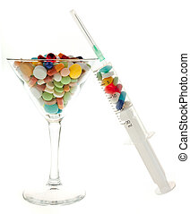 glass and tablets - glass of cocktails and medication on a...