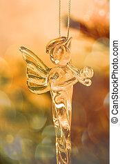 Glass angel in christmas tree