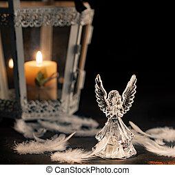 Glass angel on a dark background