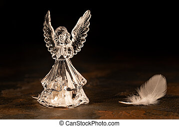 Glass angel on a dark background