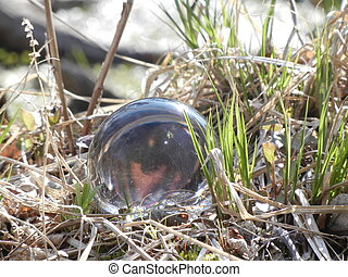 Glass ball in grass - Ball of crystal glass laying in grass