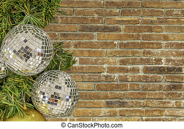 Glass ball ornaments on a Christmas tree Background brick with clipping path.
