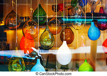 Glass balls marbles abstract colored mix in the shopwindow