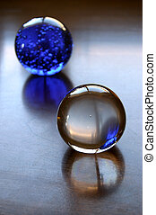 Glass Balls - Two glass balls, one clear and one blue,...