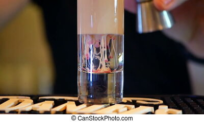 Glass bar alcohol drink - Glass bar silhouette on a red...