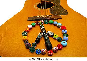 glass bead peace symbol on a guitar