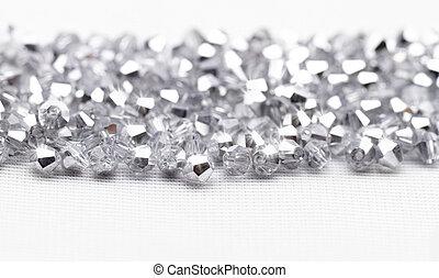 Beautiful glass beads closeup on white background