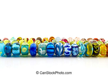 Glass beads in a line - assorted glass beads in a line