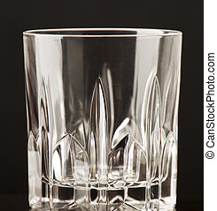 glass beaker - An empty glass beaker on a black background