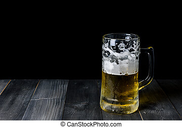 glass beer on a wooden table