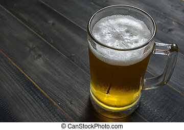 glass beer on wooden
